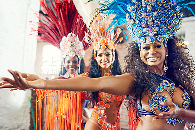Buy stock photo Shot of beautiful samba dancers performing at a carnival