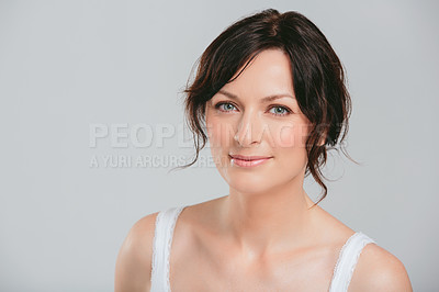 Buy stock photo Studio shot of a beautiful woman posing against a blue background