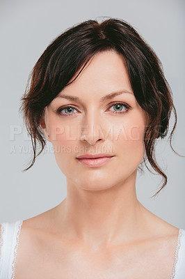 Buy stock photo Studio shot of an attractive woman posing against a gray background