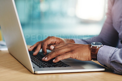 Buy stock photo Closeup shot of an unrecognizable businessman using a laptop in an office
