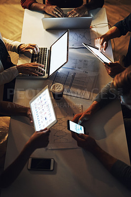 Buy stock photo High angle shot of a group of unrecognizable designers having a brainstorming session in the boardroom