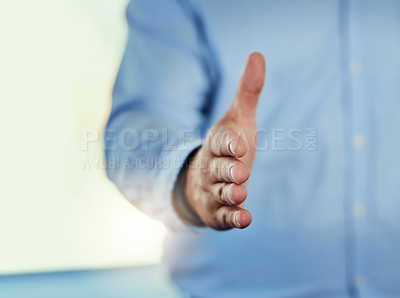 Buy stock photo Cropped shot of a businessman extending his arm for a handshake