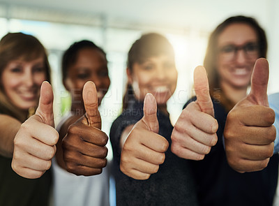 Buy stock photo Cropped shot of a group of businesswomen giving thumbs up in a modern office