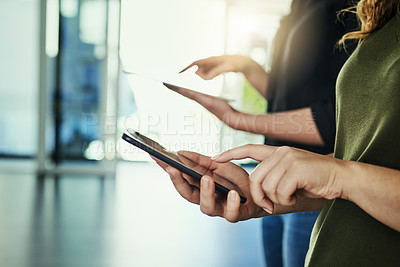 Buy stock photo Cropped shot of businesspeople using their mobile phones in a modern office