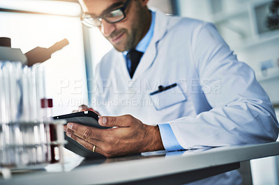 Buy stock photo Shot of a scientist using a digital tablet while working in a lab