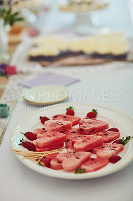Buy stock photo Shot of watermelon cut into heart shapes on a table at a tea party inside