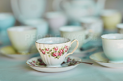 Buy stock photo Closeup shot of tea cups laid out on a table at a tea party inside