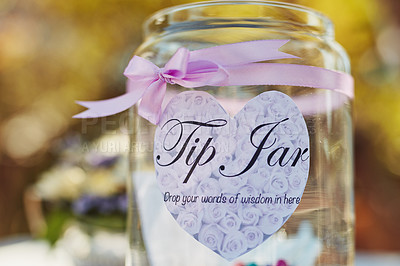 Buy stock photo Closeup shot of a words of wisdom tip jar at a tea party outside