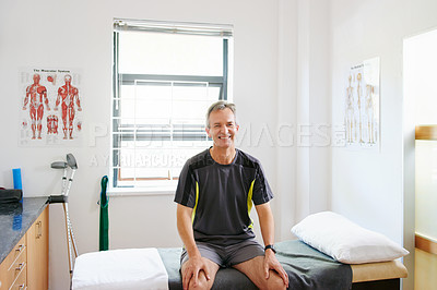Buy stock photo Shot of a mature man sitting in a physician's office