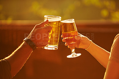 Buy stock photo Cropped shot of an unrecognizable couple toasting at a resort in nature