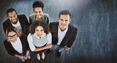Buy stock photo High angle shot of a group of businesspeople standing together in an office