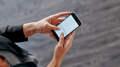 Buy stock photo High angle shot of an unrecognizable businesswoman using a cellphone in an office
