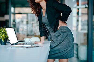Buy stock photo Closeup shot of an unrecognizable businesswoman suffering with back pain while working in an office
