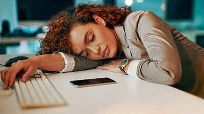 Buy stock photo Shot of a young businesswoman sleeping at her desk while working late in an office