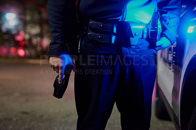 Buy stock photo Closeup shot of an unrecognizable policeman out on patrol