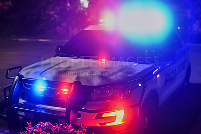 Buy stock photo Cropped shot of a police squad car outside at night