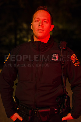 Buy stock photo Cropped portrait of a handsome young policeman out on patrol