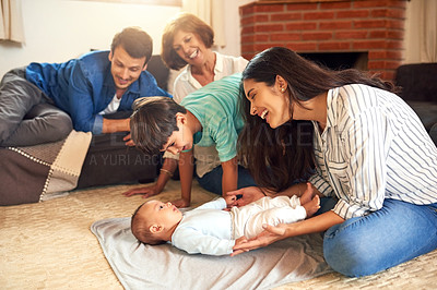 Buy stock photo Cropped shot of an affectionate young family spending quality time together at home