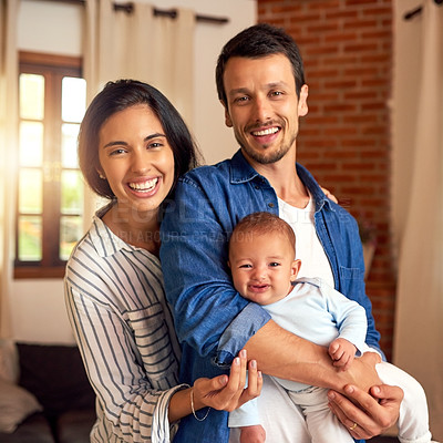Buy stock photo Cropped portrait of an affectionate young couple and their baby boy at home