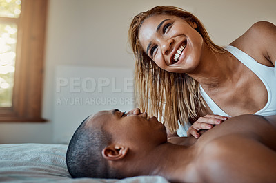 Buy stock photo Cropped shot of a loving couple spending the day at home