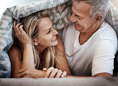 Buy stock photo Shot of an affectionate couple spending the day in bed