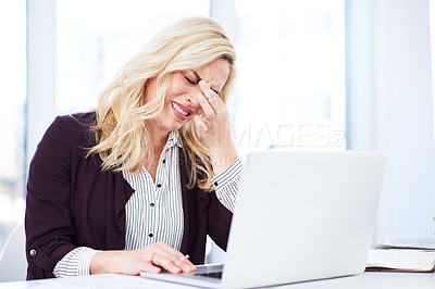 Buy stock photo Cropped shot of a young businesswoman looking very frustrated while working in her office