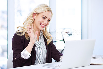 Buy stock photo Cropped shot of an attractive young businesswoman video chatting on her laptop in the office