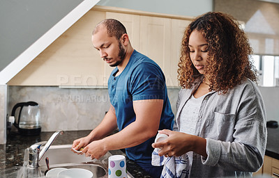 Buy stock photo Cropped shot of a young couple doing the dishes at home
