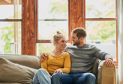 Buy stock photo Cropped shot of a young couple being affectionate on the sofa at home