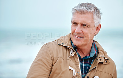 Buy stock photo Cropped shot of a handsome senior man looking thoughtful while standing outside