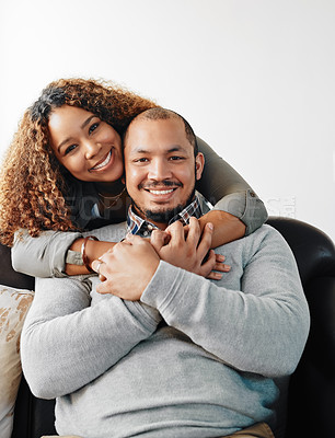 Buy stock photo Portrait of a young couple being affectionate on the couch in the living room at home
