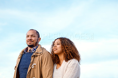 Buy stock photo Shot of a loving young couple taking a stroll on the beach