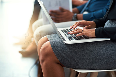 Buy stock photo Cropped shot of a businesswoman sitting in line and using a laptop
