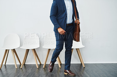 Buy stock photo Cropped studio shot of a businessman being called in to an interview