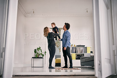 Buy stock photo Full length shot of a happy couple and their baby boy spending time together at home