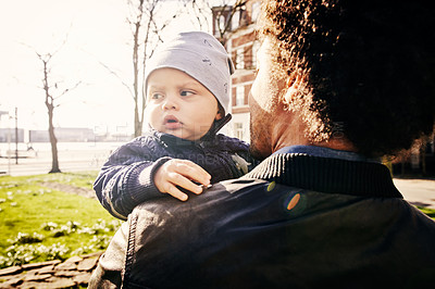 Buy stock photo Cropped shot of a handsome father and his baby boy spending time together in the park