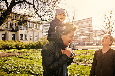 Buy stock photo Cropped shot of a happy couple and their baby boy spending time together in the park