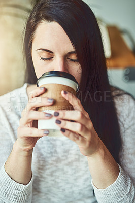 Buy stock photo Shot of a young woman drinking coffee in a cafe