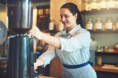 Buy stock photo Shot of a young barista working in a cafe