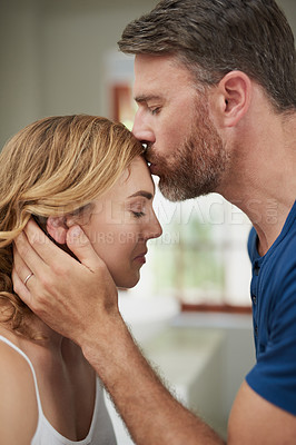 Buy stock photo Shot of a happy middle aged couple sharing an affectionate moment at home