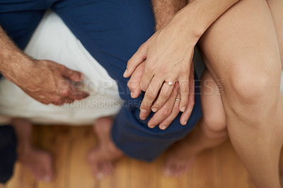 Buy stock photo Closeup shot of a couple sitting on the bed and holding hands at home