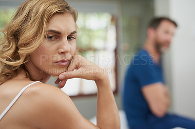 Buy stock photo Shot of a mature couple having marital problems in the bedroom at home