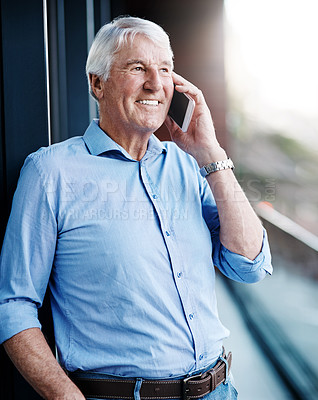 Buy stock photo Cropped shot of a senior businessman on a call outside the office