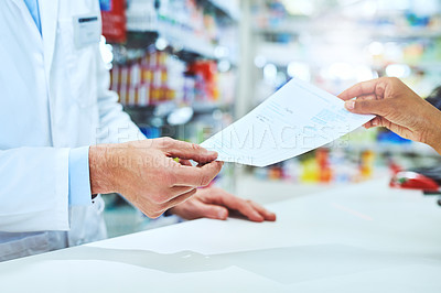 Buy stock photo Cropped shot of an unrecognizable male pharmacist helping a female customer in the pharmacy