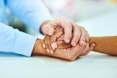 Buy stock photo Cropped shot of two unrecognizable people holding hands in comfort