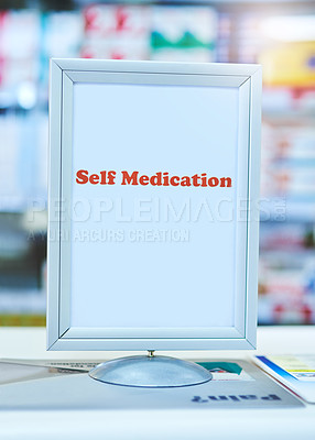 Buy stock photo Shot of a sign with the words 'self medication' written on it at a pharmacy