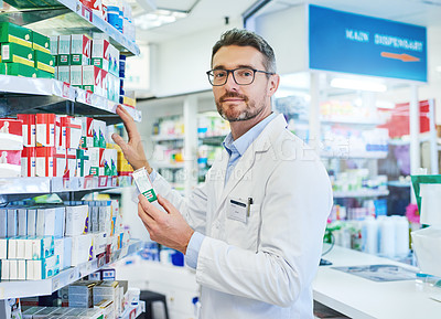 Buy stock photo Shot of a mature pharmacist working in a pharmacy