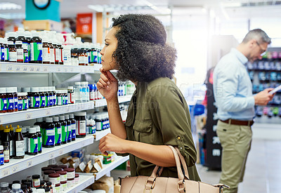 Buy stock photo Cropped shot of a female customer in a pharmacy