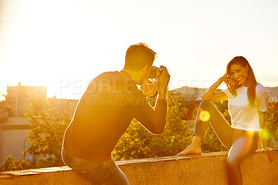 Buy stock photo Shot of a couple taking pictures while out on a date
