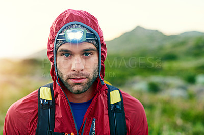 Buy stock photo Cropped portrait of a handsome young male athlete out for a morning run